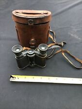 VINTAGE  WW1 USA SMALL FIELD GLASS BINOCULARS WITH BLACK LEATHER STRAP IN CASE.