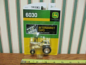 John Deere 6030 2012 Orlando Aftermarket Expo Gold By Ertl 1/64th Scale >