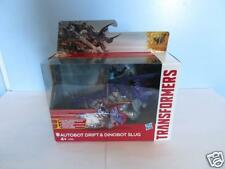 TRANSFORMERS:  autobot drift & dinobot slug -new in box-