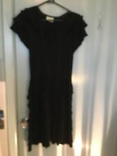 Review black cotton dress in a Spanish style in size 10