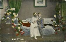 Love RomanceCourting Young Couple of Sofa surrounded by flowers Postcard
