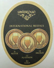 UNIBROUE INTERNATIONAL MEDALS Beer COASTER, MAT, Chambly, Quebec, CANADA Bottles