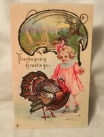 Embossed Thanksgiving Postcard THANKSGIVING GREETINGS Girl and Turkey glittery