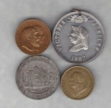 FOUR OLD COMMEMORATIVE MEDALS IN A USED CONDITION