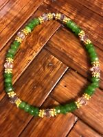 Lovely 2x4mm Green Peridot, Clear Crystals, Bali Gold Beads. Stretch Bracelet