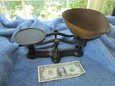vintage balance scale with brass pan