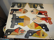 Lot 9 Advertisement Pistol Gun Paper Cardboard; Indian, Esso, Amoco, Pops, Syrup