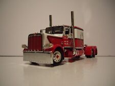 DCP 1/64 RED AND WHITE 389 PETERBILT WITH 63'' FLAT TOP SLEEPER