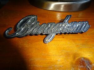 Vintage car Cadillac Brougham Emblem Badge