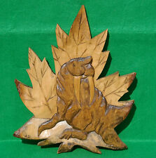 Large wallhanging carving of a walrus backed by a mapleleaf in maple hardwood