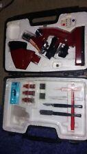 Lighted Tasco Red Microscope in Black Case