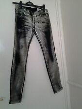 Atteint Fit Slim noir Jeans