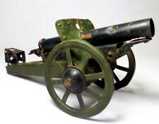 VINTAGE WWI ENAMEL PRESSED TIN MINIATURE CANNON REPLICA MODEL TOY IN GRN/BLK PNT