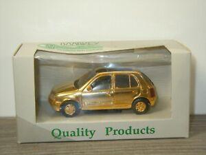 Nissan Micra 5-Door Gold Version - Doorkey 1:43 in Box *53490