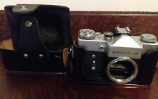 Vintage Zenit B SLR film camera body with leather case.