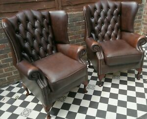 Superb Pair of Chesterfield brown leather wingback armchairs