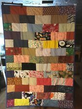 Handmade toddler or lap patchwork quilt. Measures about 42X63 inches.