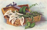 JOYOUS EASTER~LILLIES IN BASKET~CLAPSADDLE  EMBOSSED GREETING POSTCARD 1910s