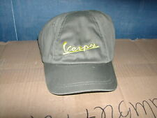 Vespa logo baseball style cap in olive green with yellow text