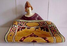 AUSTRIAN / CZECH ART NOUVEAU POTTERY DISH OF A FEMALE FIGURE CARPET SELLER.