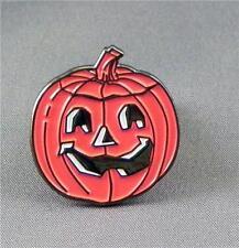 Pumpkin face pin badge. Halloween novelty badge