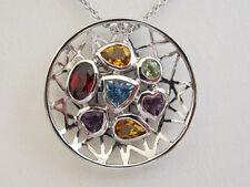 18k. White Gold Multi Gemstone Circle Pendant, New