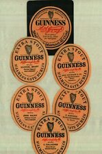 Old Guinness bottle labels from Irish pubs in Tullamore, Edenderry, Mountrath