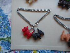 Vintage 50's kitsch novelty dog charm bracelet, red and black plastic terriers
