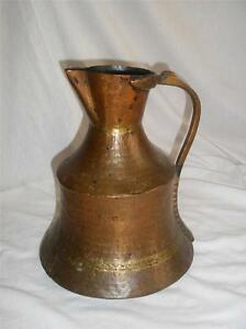 Very unusual old hand crafted copper flagon
