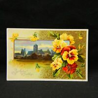 BIRTHDAY GREETINGS EMBOSSED POSTCARD WITH TOWN SCENE & FLOWERS DATED 1913