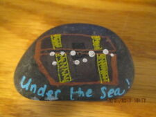 """Painted rock """"Under the Sea"""" with painted treasure chest on rock"""