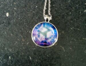 Reiki Design Glass Cabochon Desgn Pendant/ Necklace With A Silver Coloured chain