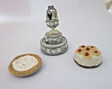 3 Penny Arcade metal doll house 2 cakes , 1 pie      130