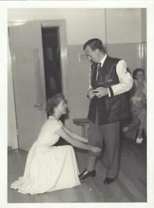 LADY IN PRETTY DRESS TURNING UP A MANS TROUSERS   - VINTAGE  PHOTOGRAPH