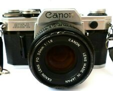 Canon AE-1 35mm SLR Film Camera with FD 50mm Lens, Inc New PX 28 Battery.