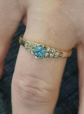 Solid Gold 375 Ring With Blue Stone And CZ stones.