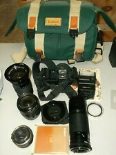 canon t70 35mm camera with extras (LENS)