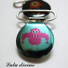 1 Pince bretelle, Attache tétine Turquoise Petit monstre rigolo rose/violet 25mm