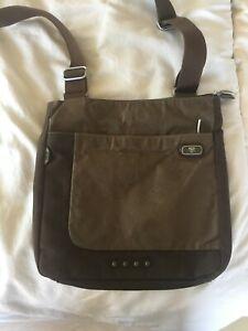 Brown Ballistic Nylon Tumi messenger style bag that holds an IPad.