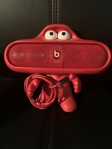Beats Pill Speaker And Dude Character Stand