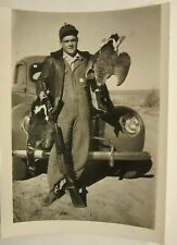 """1940 Ford Deluxe Coupe, 4 5/8"""" x 3 3/8"""", b&w photo. Goose Hunter with shotgun"""