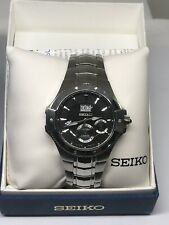 Seiko kinetic Coutura watch SNP007 Black Dial, Stainless in box w/ papers