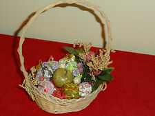 small Christmas basket w/fruit and small gift boxes inside