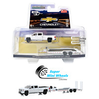 Greenlight 1/64 Hitch & Tow Chevrolet Silverado 3500 Dually with Flatbed Trailer