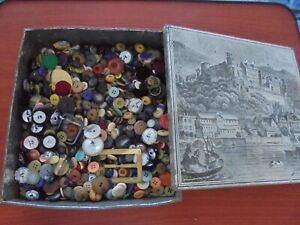 vintage tin of old buttons