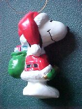 Peanuts Snoopy as Santa Ringing Bell with Bags of Toys Christmas Ornament