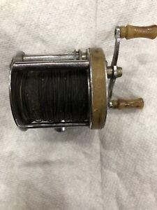VINTAGE SHAKESPHEARE TRIUMPH 1958 MODEL GE FISHING REEL BAKELITE HANDLES