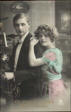 Christmas Man & Beautiful Woman Couple RUSSIAN Tinted Real Photo Postcard