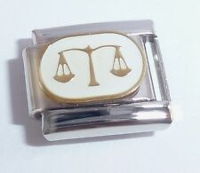 Libra Sep 24 Oct 23    English  Sterling silver charm. code 215