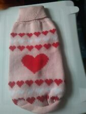 NEW DOG JUMPER, IN PEACH  WITH HEARTS ON.